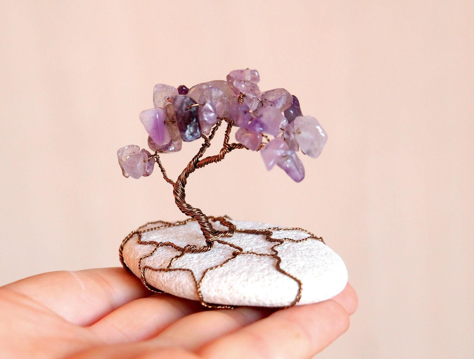 Wire tree sculture with Amethyst in natural beach stone.
