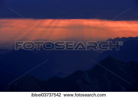 """Stock Photo of """"Sunrise over the Ammer Mountains with a dramatic."""