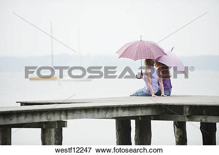Picture of Germany, Bavaria, Ammersee, Two Women sitting on jetty.