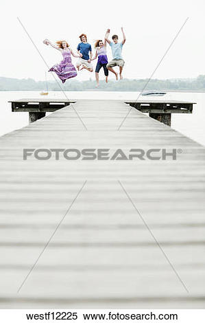 Stock Image of Germany, Bavaria, Ammersee, Four friends on jetty.