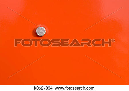 Stock Photo of Orange panel and bolt head k0527834.