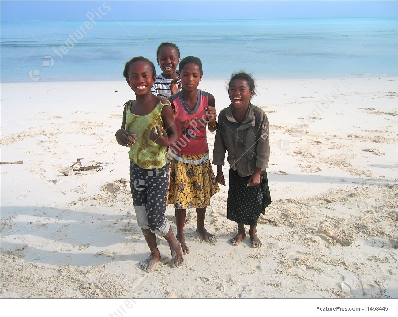 Image Of Young Children Playing On The Beach, Anakao, Madagascar.