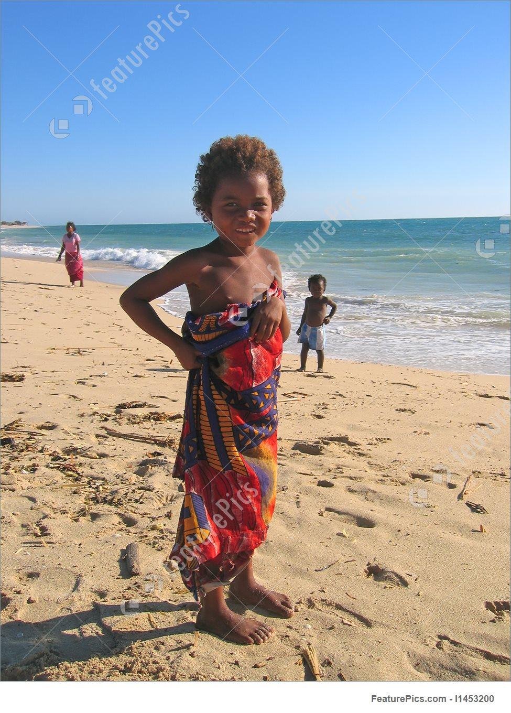 Girl Playing On The Beach, Anakao, Madagascar Image.