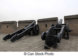 Stock Photo of iron cannon in the ancient city walls, the ancient.