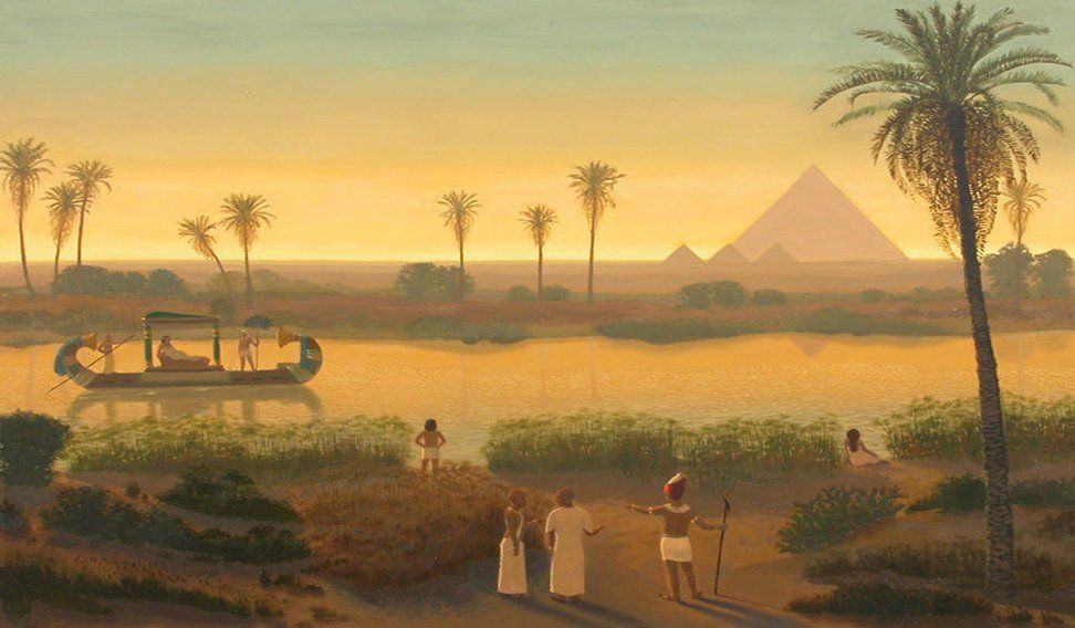 Sunset On The Nile At Giza Pyramids.