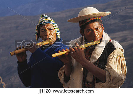 Stock Photography of Quechua Indians playing flute at village.
