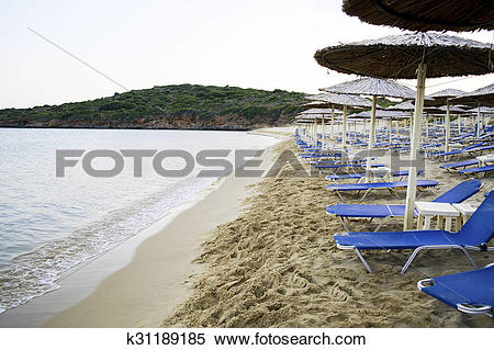 Stock Image of empty beach in Andros Greece k31189185.