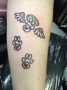 angel wings with paw print.