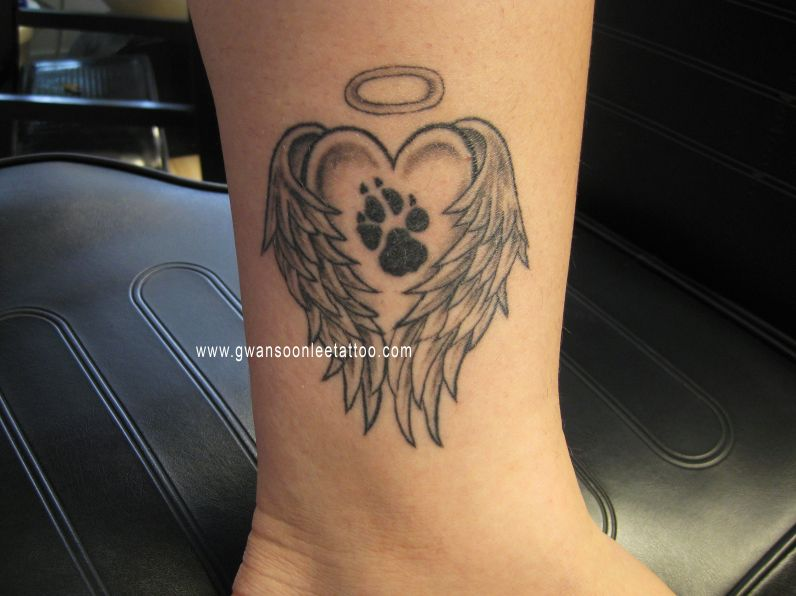 paw print tattoos with angel wings.