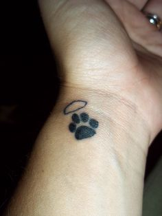 Angel wing paw print tattoo.