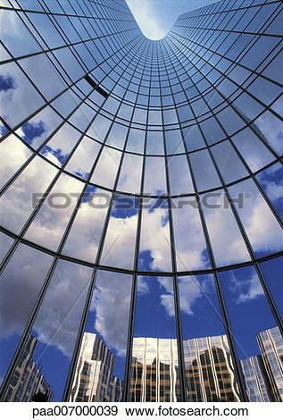 Stock Photograph of France, Paris, glass facade of skyscraper.