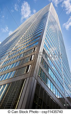 Stock Photo of low angle shot of tall commercial building.