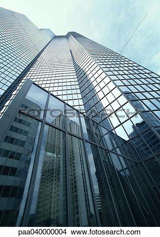 Stock Photo of Skyscraper, building reflected in window panes, low.