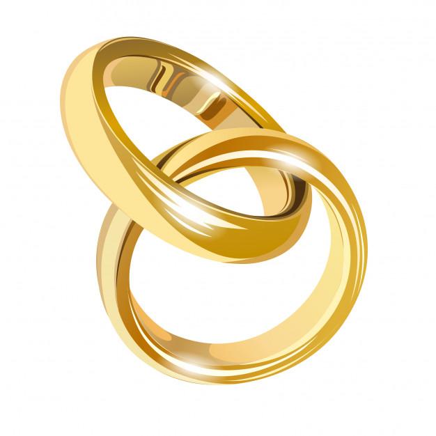 Anillos de boda de oro aislados en blanco.