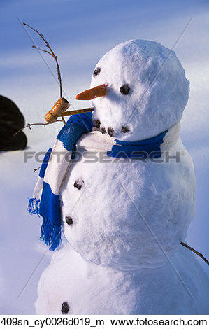 Stock Photo of Snowman in forest making snow angel imprint in snow.