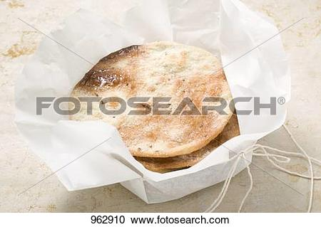 Stock Photography of Caramelised aniseed biscuits in paper (Spain.