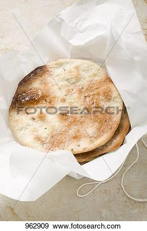 Stock Photograph of Caramelised aniseed biscuits in paper (Spain.