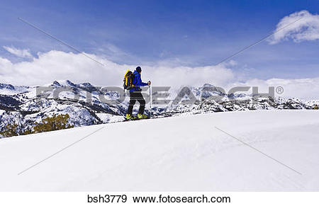Stock Photograph of Backcountry skier under Banner and Ritter.