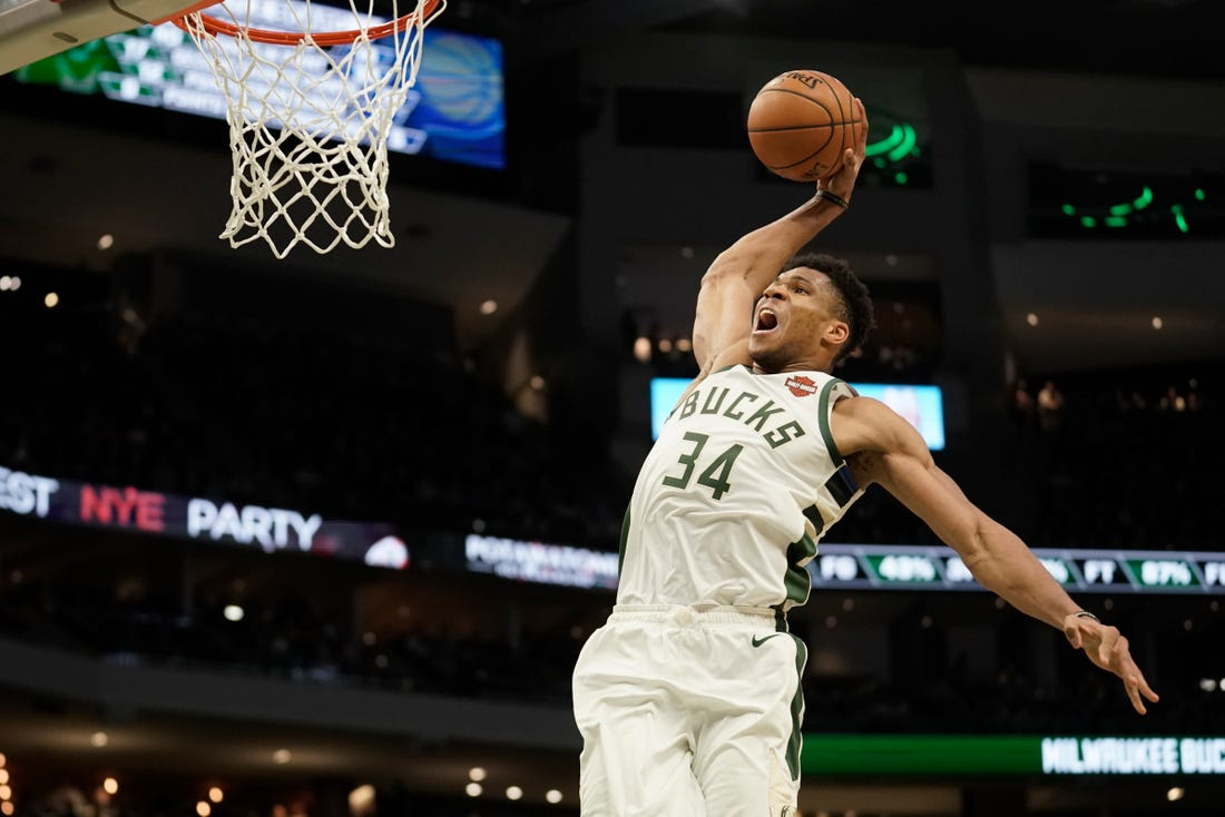 Bucks back on Christmas, led by more complete Antetokounmpo.