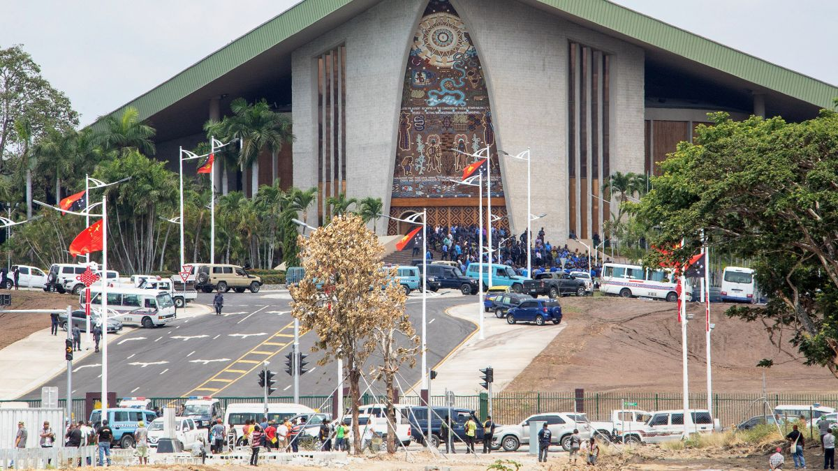 PNG police officers attack parliament in APEC pay dispute.