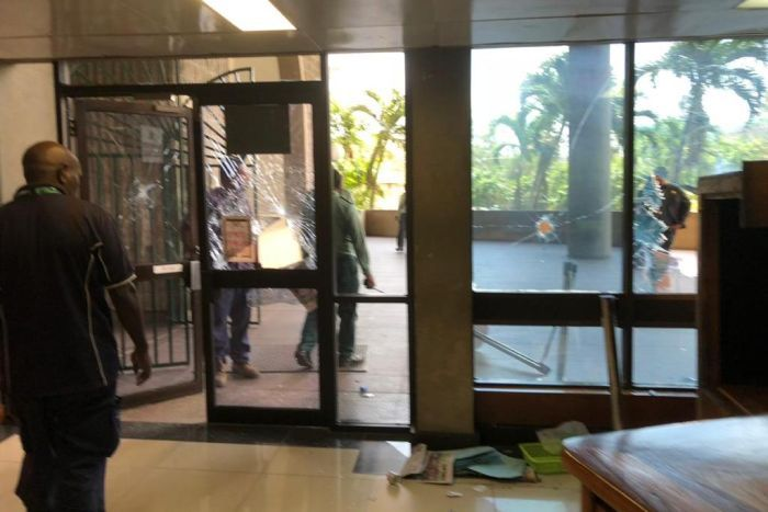 PNG Police storm Parliament over lack of APEC payments, ABC.