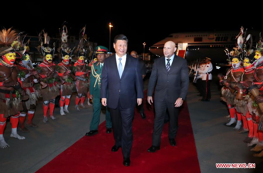 Xi arrives in PNG for state visit, APEC meeting.
