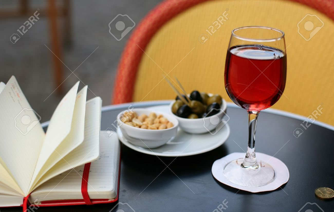 Parisian Street Cafe Table With Traditional French Aperitif Kir.