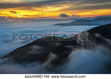"""Stock Photo of """"Sunrise above the clouds, Mount Cucco, Umbria."""
