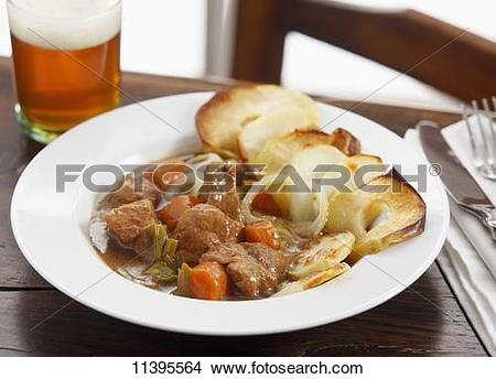 Stock Photo of Beef casserole with fried apple rings 11395564.