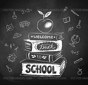 Chalk drawing of apple on stack of books.