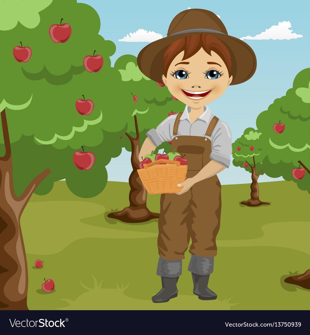 Farmer little boy picking apples.