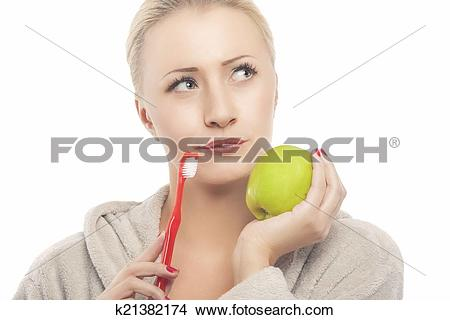 Stock Photo of Blond Woman in Dressing Gown Holding Green Apple.