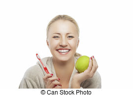 Stock Photo of Portrait of young woman holding an apple and.