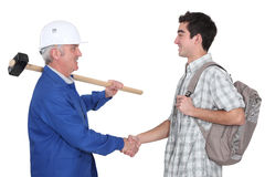 Experienced Tradesman Meeting New Apprentice Royalty Free Stock.