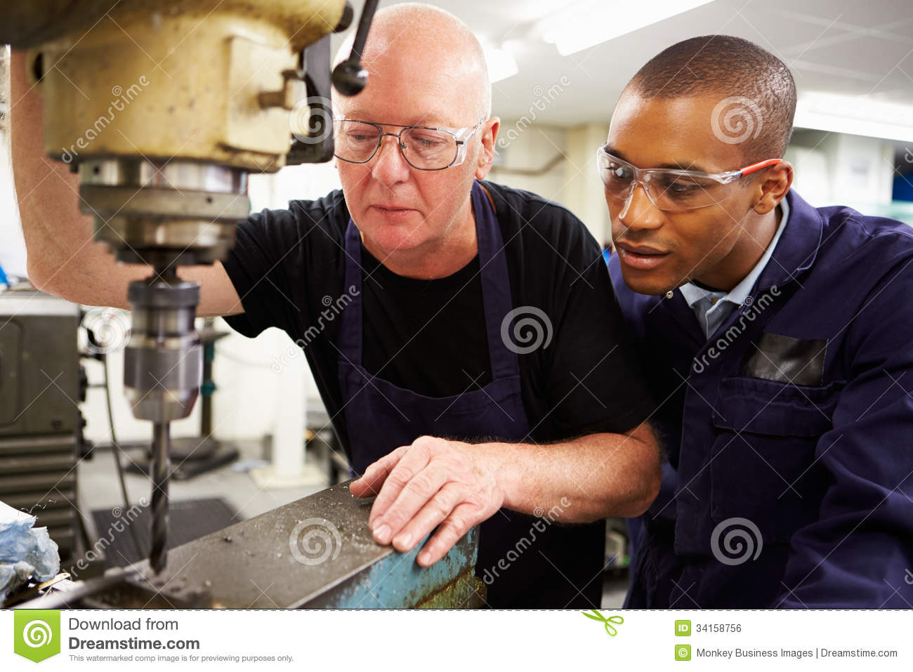 Engineer Teaching Apprentice To Use Milling Machine Royalty Free.