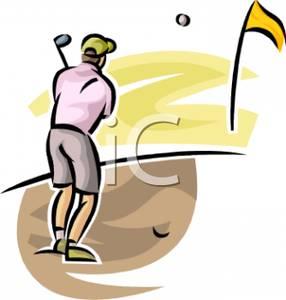 Golfer Hitting an Approach Shot Towards the Putting Green.
