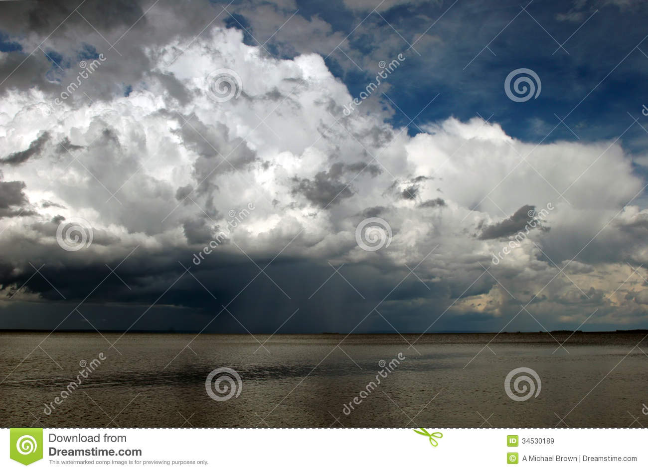 Approaching Storm Clouds Over Water Royalty Free Stock Images.