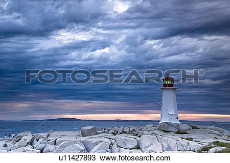 Stock Photo of Lighthouse at Peggy's Cove during approaching storm.