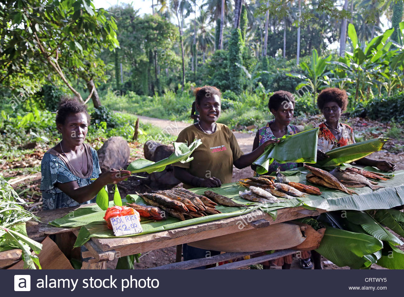 women wave flies of the fishes, market stall on the road to Arawa.