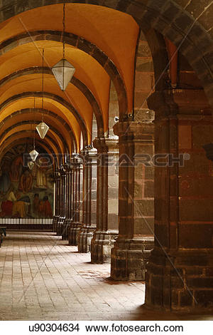 Stock Photo of Main arched plaza walkway with hanging lights and.