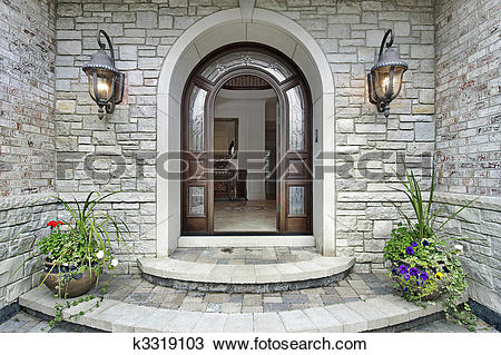Stock Photo of Arched stone entry to luxury home k3319103.