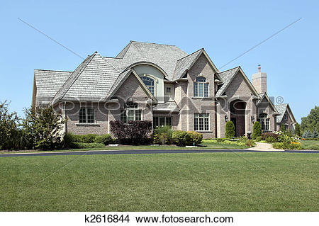 Stock Photo of Large brick home with arched entry k2616844.