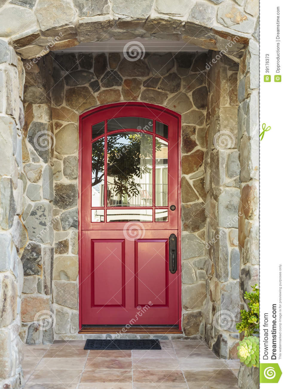 Stone House And Red Front Door Stock Photo.