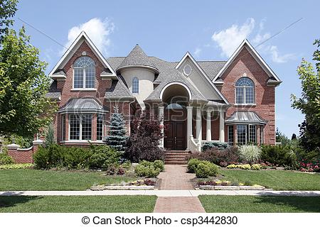 Stock Photography of Luxury home with turret and arched entry.