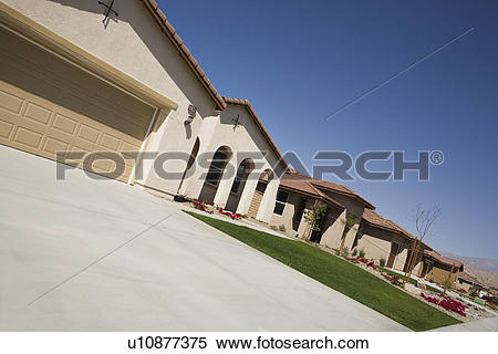 Stock Image of New House With Large Garage and Arched Entry.