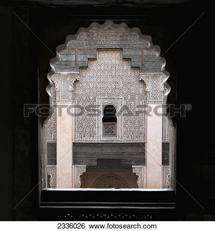 Stock Images of An arched window with a view of a wall with ornate.