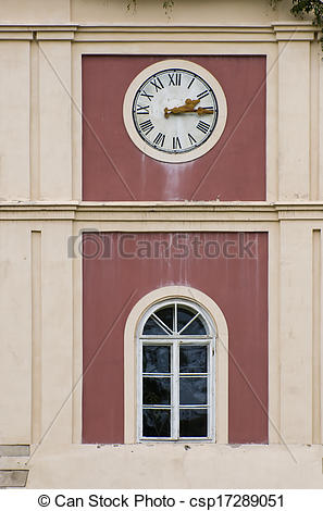 Stock Images of Clock on tower above an arched window on an.