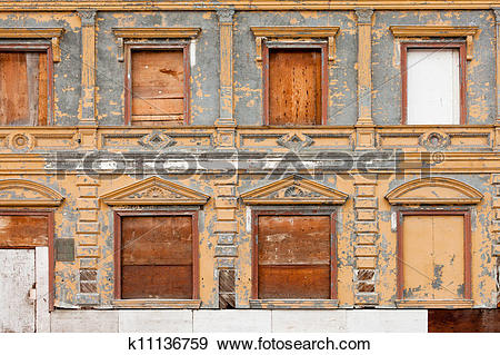 Stock Photograph of Boarded up derelict building facade peeling.