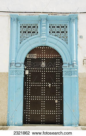 Stock Photo of A Bright Blue Painted Frame Over An Arch Door In.