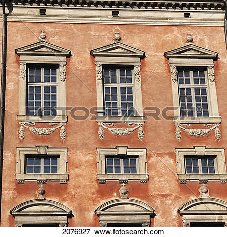 Picture of Facade on a painted orange building in old town.